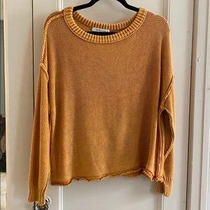 Light orange/yellow knit sweater